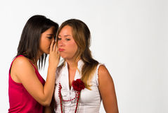 Girlie gossip. Latest confidential gossip being whispered into her ear Royalty Free Stock Images