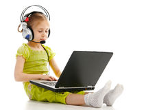 Girlie in headphones with laptop Royalty Free Stock Photo