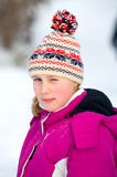 Girlie in snow. Portrait of girlie in winter stock image