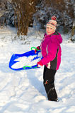 Girlie in snow. Portrait of girlie in winter stock images