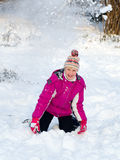 Girlie in snow. Child play in snow day royalty free stock photos