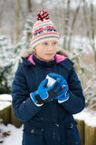 Girlie in snow. Young Girl Playing in Snow stock photography