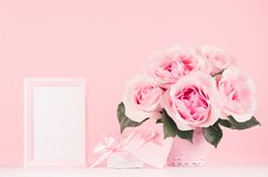 Girlish gentle Valentine days interior - blank frame for text, exquisite pink roses, gift box, heart with ribbon and bow on wood. stock photography