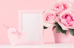 Girlish gentle Valentine days mockup - blank frame for text, exquisite pink roses, heart with ribbon, gift box on white wood. royalty free stock photo