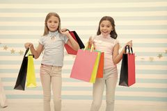 Girlish happiness. Kids happy carry bunch packages. Shopping with best friend concept. Girls like shopping. Kids happy. Small girls hold shopping bags. Enjoy royalty free stock images