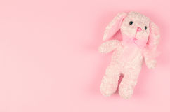 Girlish soft toy on a pink gentle background Stock Photography