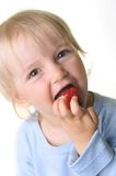 Girll eat strawberry Royalty Free Stock Photos