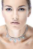 Girll in necklace Royalty Free Stock Photos