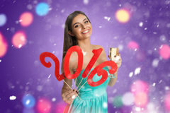 Girll showing decorative sign of New Year. Young woman showing decorative red sign of New Year Royalty Free Stock Image