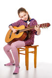 Girll teenager playing a guitar Royalty Free Stock Images