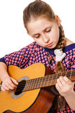 Girll teenager playing a guitar Royalty Free Stock Photos