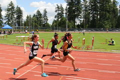 Girls on the 100 meters dash Royalty Free Stock Images