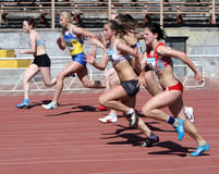 Girls on the 100 meters race Stock Photos