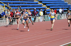 Girls on the 100 meters race Royalty Free Stock Photos