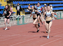 Girls on the 100 meters race Royalty Free Stock Photo
