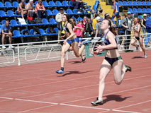 Girls on the 100 meters race Stock Photography