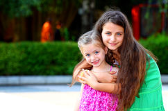 Girls. Two little girls,(sisters) holding each-other outdoor royalty free stock image