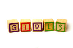 Girls. Made from wooden blocks Stock Photos