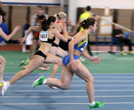 Girls on the 60 meters dash Stock Photos