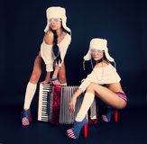 Girls with accordion. Stock Photography