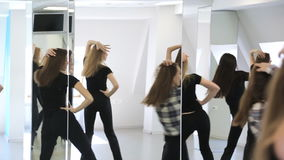 Girls actively move in dancing class on lesson of choreography. stock video footage
