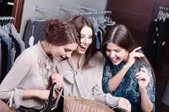 Girls admire the purchases Royalty Free Stock Images