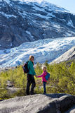 Girls against the backdrop of a glacier Royalty Free Stock Photos