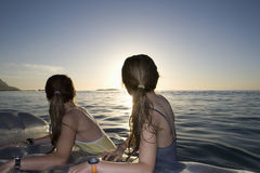 Girls On Air Mattress Enjoying The Sunset Stock Images