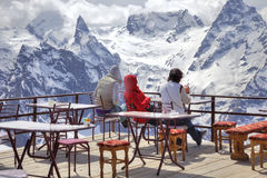 Girls are in an alpine cafe Stock Image