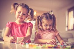 Girls also can play with Lego blocks. Lego blocs are funny for play royalty free stock photo