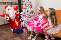 Girls ambush for Santa Claus Stock Photography