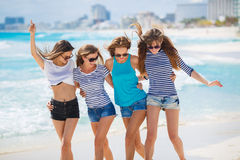 Girls amid a tropical beach. Stock Photography