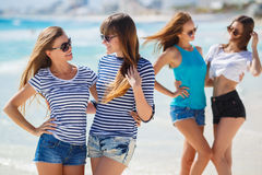 Girls amid a tropical beach. Royalty Free Stock Images