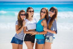 Girls amid a tropical beach. Royalty Free Stock Photography