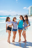 Girls amid a tropical beach. Stock Photos