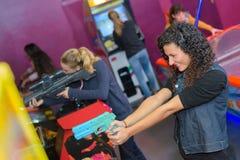 Girls at amusement arcade. Girls at the amusement arcade Stock Photos