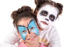 Girls with face-paint. Girls with animal face-paint isolated in white royalty free stock photos