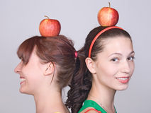 Girls with apple Stock Photos