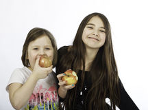 Girls with apple Royalty Free Stock Images