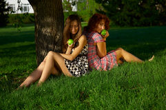 Girls with apples Royalty Free Stock Photo