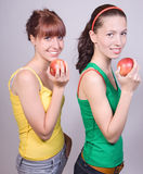 Girls with apples. Two teens girls with apples Stock Photo