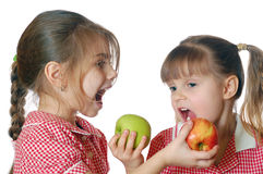 Girls with apples Stock Photography