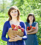 Girls with apples harvest in garden Stock Photo