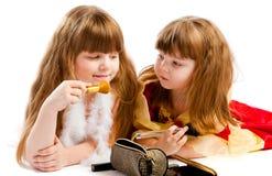 Girls applying makeup Royalty Free Stock Image