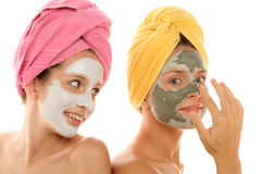 Girls applying mask Royalty Free Stock Photo