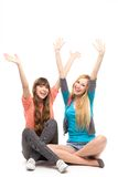 Girls with arms raised. Two women with arms raised Stock Photography