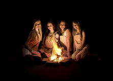 Girls around campfire Royalty Free Stock Photo