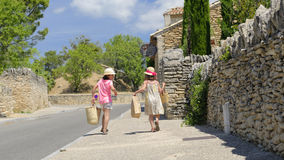Girls arriving from market in Provence Stock Photography