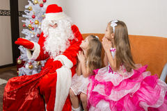 Girls are asking for frost gifts grandfather Royalty Free Stock Photos