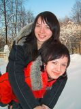 Girls astride the friend on the friend stock image